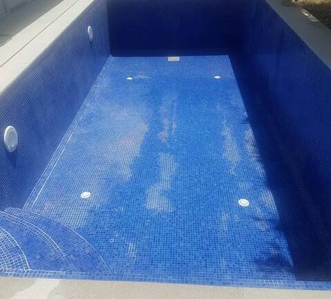 The real cost of owning a swimming pool